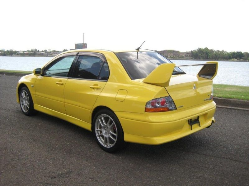 2003 Mitsubishi Lancer EVO 8 GSR yellow left rear