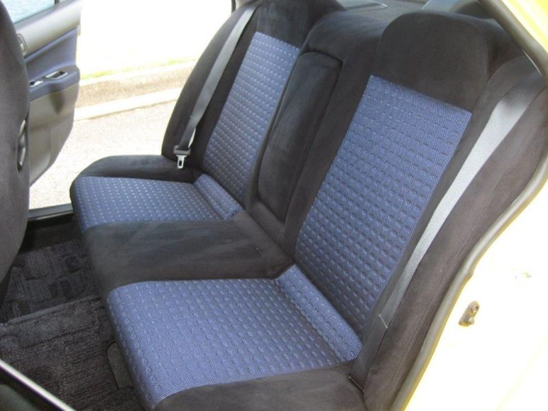 2003 Mitsubishi Lancer EVO 8 GSR yellow rear seats