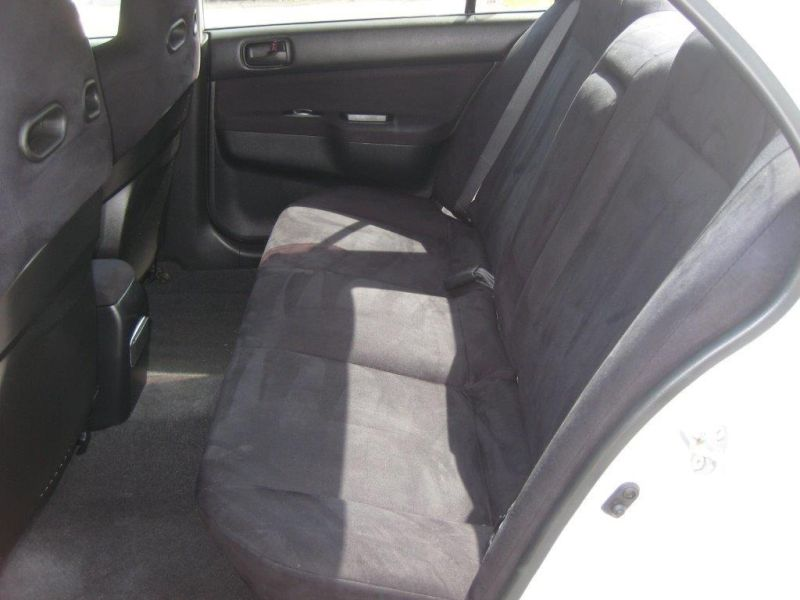 2004 Mitsubishi Lancer EVO 8 GSR white rear interior