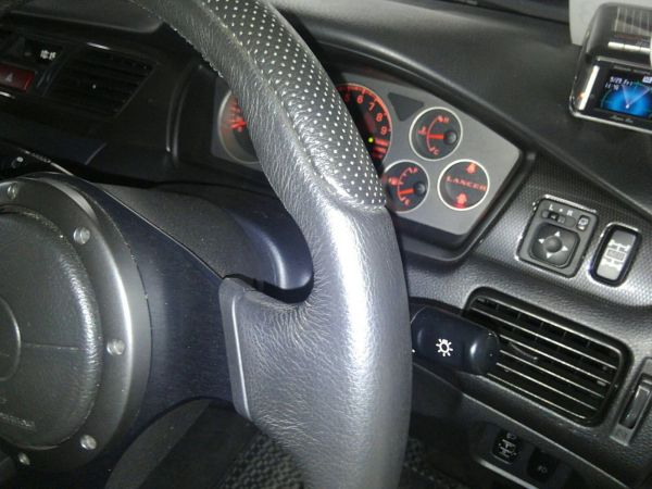 2004 Mitsubishi Lancer EVO 8 MR steering wheel closeup