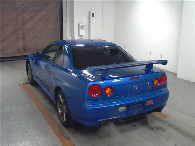 1999 Nissan Skyline R34 GT-R VSpec TV2 Bayside Blue auction left rear