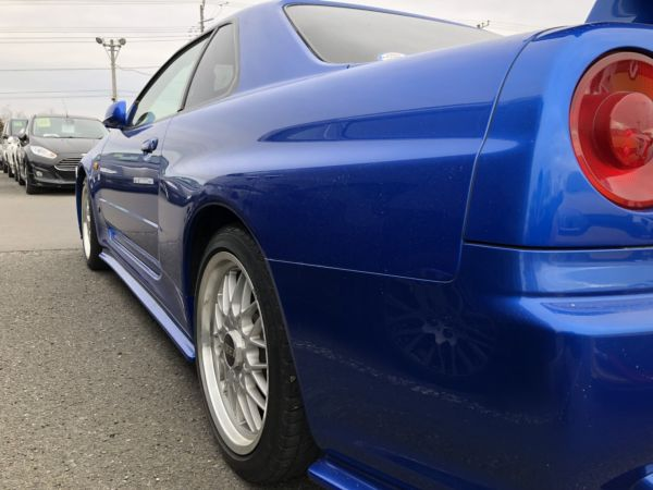 1999 Nissan Skyline R34 GTR VSpec Bayside Blue left rear quarter