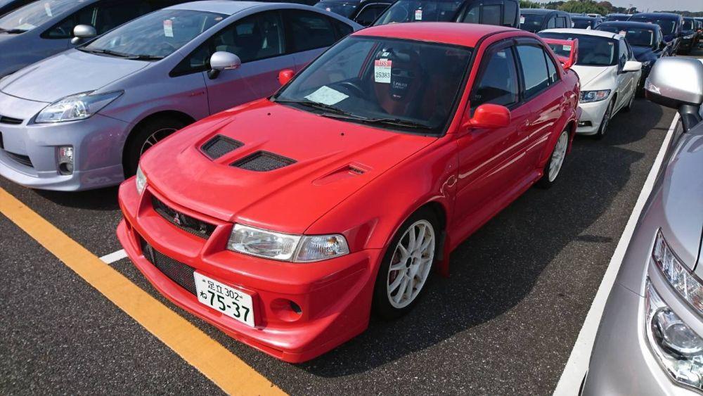 2000 Mitsubishi Lancer EVO 6 TME red left front